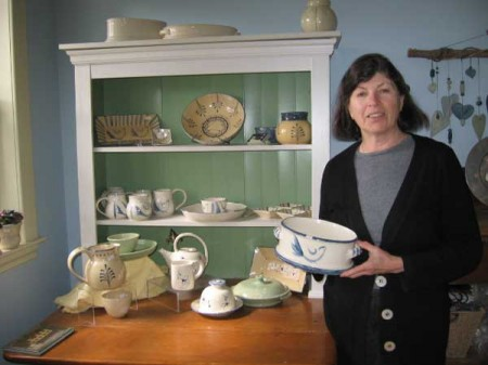 Suzanne in front of some of her lovely ceramics