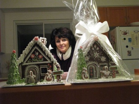 Niki with two of her award winning Gingerbread houses